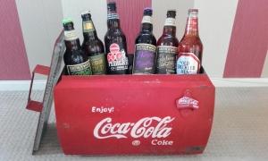 Vintage Coca Cola cooler full of random real ales