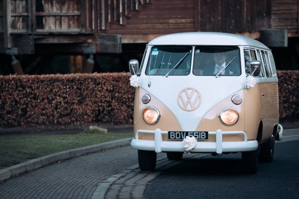 Arriving for wedding in a VW Campervan at Alnwick Treehouse
