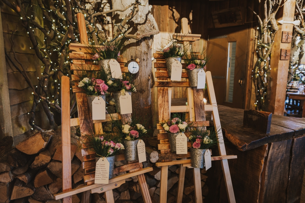 Alnwick Treehouse inside showing flower board feature at wedding