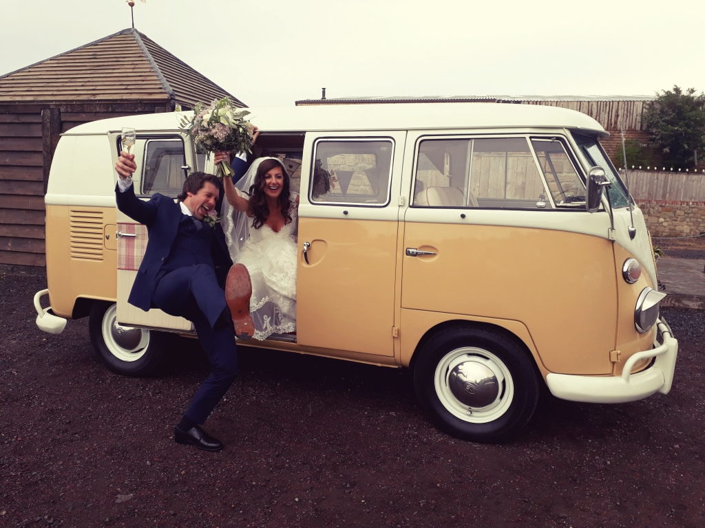 Campervan outside of The South Causey Inn with Bride and Groom in Celebration Pose